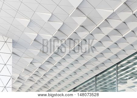 Abstract shot of facade with white triagles