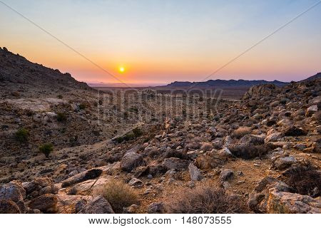 Colorful Sunset Over The Namib Desert, Aus, Namibia, Africa. Orange Red Violet Clear Sky At The Hori