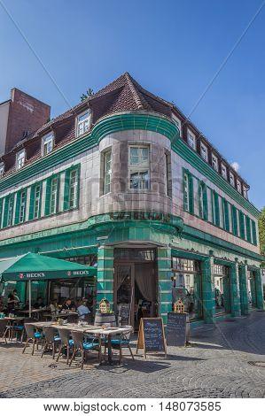 BIELEFELD, GERMANY - SEPTEMBER 6, 2016: Historical cafe Kachelhaus with people enjoying the sun in Bielefeld, Germany