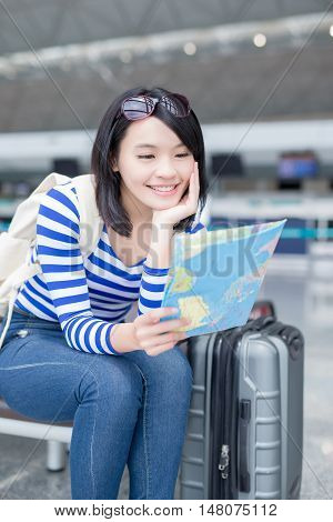 beauty woman take map and smile happily in hong kong airport asian