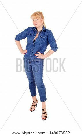 A pretty woman in jeans pants and jacket standing from the front with hands on hip isolated for white background.