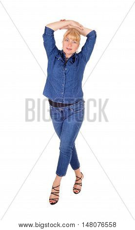 A lovely woman in jeans and jeans jacket standing isolated for white background lifting her hands over her head.