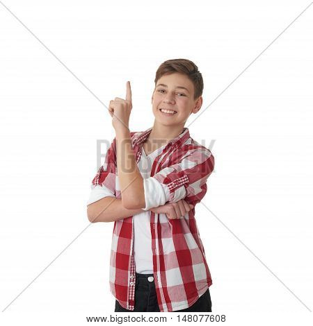 Cute teenager boy in red checkered shirt edifying over white isolated background, half body