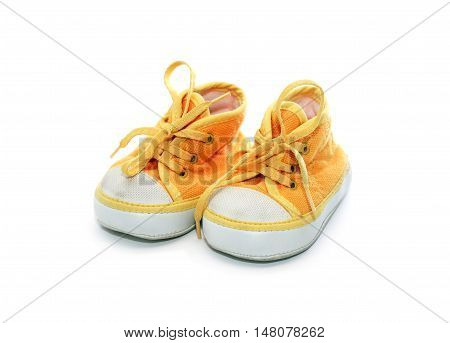 Nice yellow baby shoes on white background