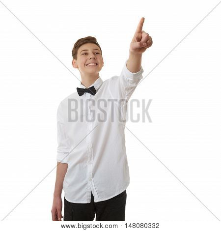 Cute teenager boy in white shirt and black bow tie pointing up side over white isolated background, half body