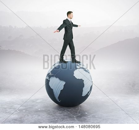 Young businessman in suit balancing on abstract globe. Landscape background. 3D Rendering