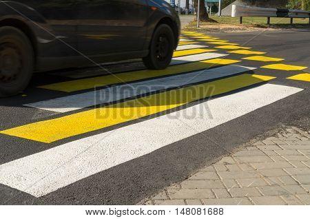 Crosswalk yellow-white warning bright color. Road markings.