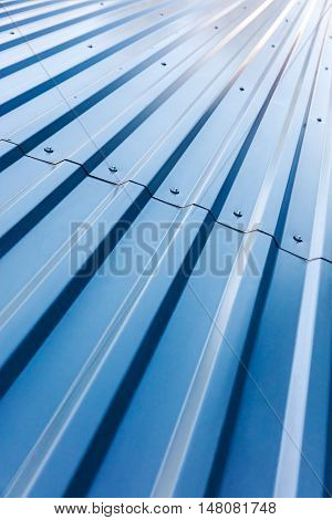 blue corrugated steel roof with rivets industrial background