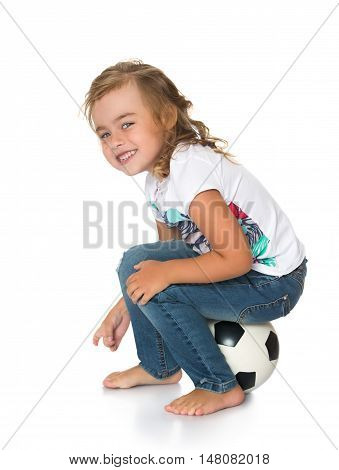 Cute little girl with beautiful grey eyes . Sitting on the ball - Isolated on white background