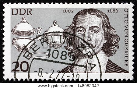 GERMANY - CIRCA 1977: a stamp printed in Germany shows Otto von Guericke Physicist and Magdeburg Hemispheres circa 1977