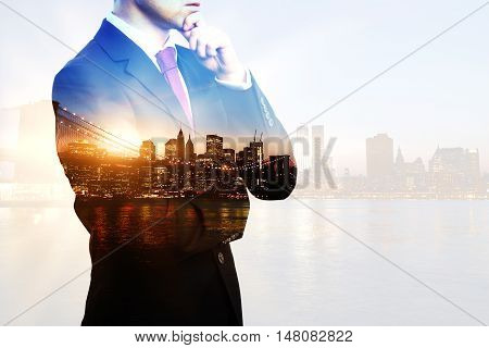 Creative image of thoughtful businessperson in suit and tie on city background with sunlight. Double exposure