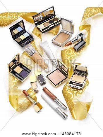 Set of colorful cosmetics. Nail polish shadows compact powder and lipsticks. Chistmas gift concept.