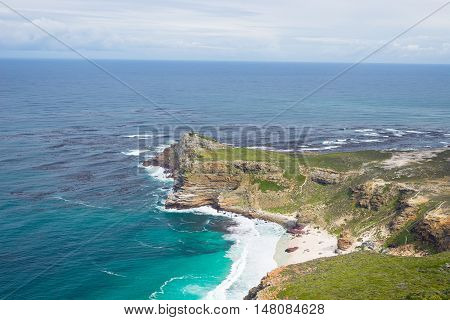Cape of Good Hope and Dias Beach viewed from Cape Point among the most scenic travel destination in South Africa. Table Mountain National Park Cape Peninsula.