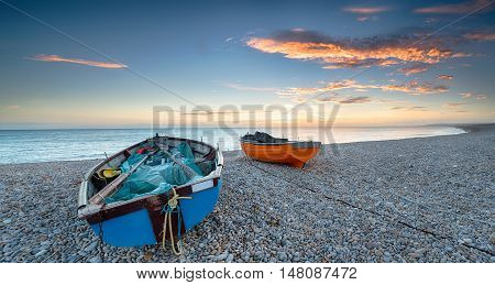 Boats On A Pebble Beach