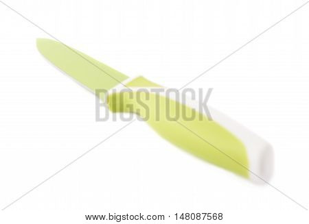 Steel green kitchen knife isolated over the white background