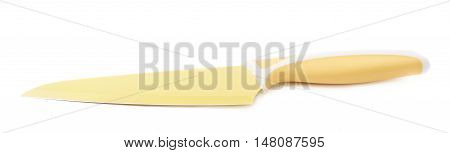 Steel yellow kitchen knife isolated over the white background