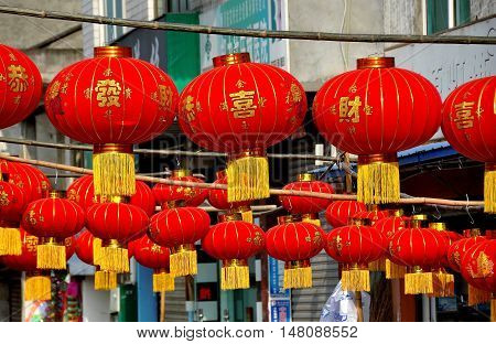 Jun Le China - January 25 2014: Rows of bright red lantern decorations for the Chinese Lunar New Year holiday hang in front of a hardware store