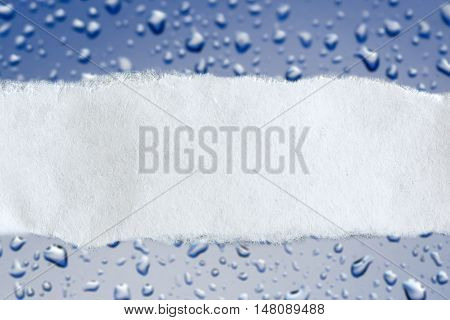 Ragged Piece Of Paper On Wet Glass