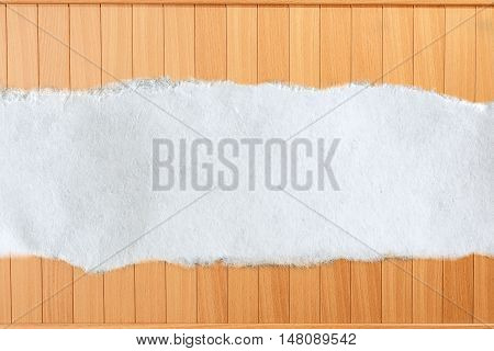 Ragged Piece Of Paper On Wood