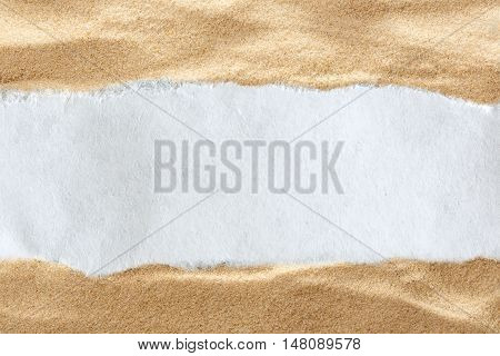Ragged Piece Of Paper On Sand