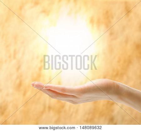 Female Hand Holding Light