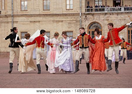 GATCHINA, ST. PETERSBURG, RUSSIA - SEPTEMBER 10, 2016: Actors in retro costumes dancing in the show in front of Gatchina palace during the festival Gatchinskaya Byl. The festival is held in first time