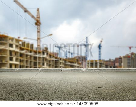 Many Tall Buildings And Cranes