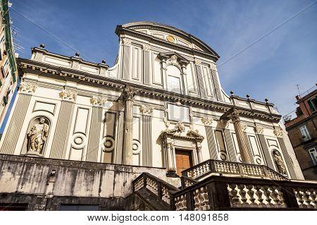 view of the facade of Basilica di San Paolo Maggiore San Paolo Maggiore Church on Via dei Tribunali in Naples, Campania, Italy.