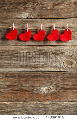 Love Hearts Hanging On Rope On A Grey Wooden Background