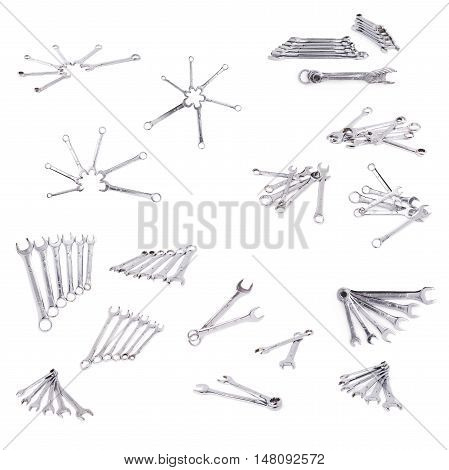 Set of wrenchs chrome metal spanner instruments isolated over white background