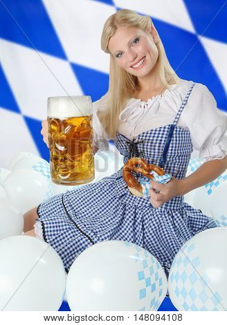 Bavarian Woman with Oktoberfest Beer sitting in a flock of balloons