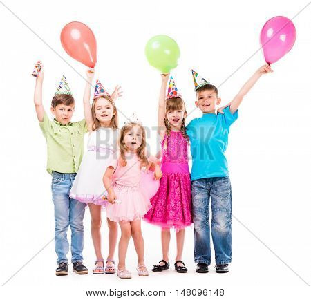 cute little children laughing with hands up and colorful baloons