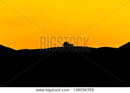 Car silhouette which off-road in the mountainous area.