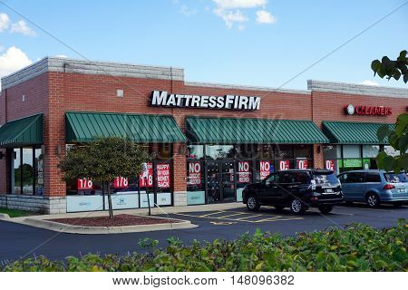 PLAINFIELD, ILLINOIS / UNITED STATES - SEPTEMBER 17, 2016: One may purchase mattresses at the Mattress Firm store in a Plainfield strip mall.