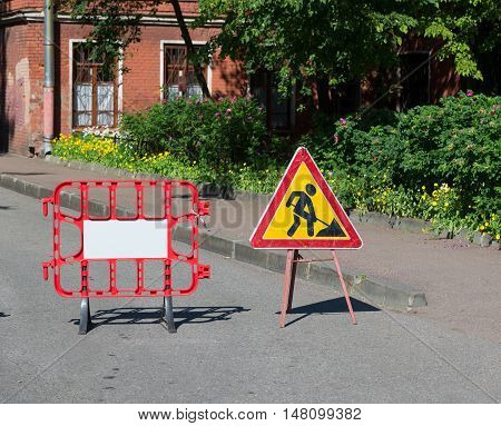 Road works sign for repairs in the courtyard
