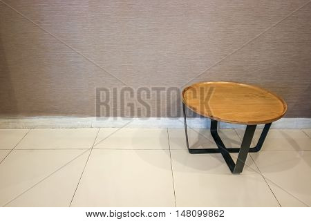 luxury wooden round side table on wall background with clipping path