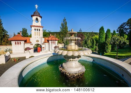 Fountain and entrance gates with bell tower, at Curchi Orthodox Christian Monastery, Moldova