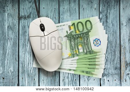 Computer Mouse And Euro Banknotes