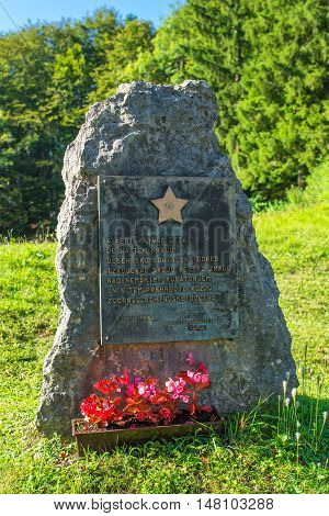 RIBCEV LAZ SLOVENIA - AUGUST 25 2016: Memorail stone monument to the Slovenian Partisans from WWII in Ribcev laz on Bohinj lake