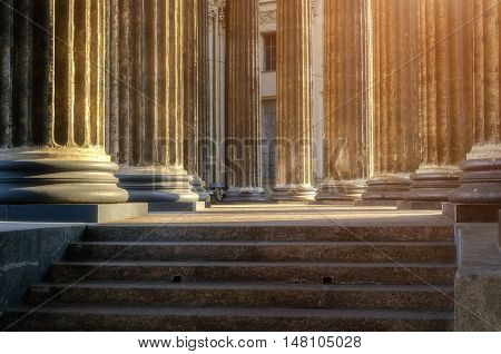 Architecture details - columns and stairs under sunlight. Architecture landscape - colonnade of the Kazan Cathedral in St Petersburg, Russia. Soft filter applied. Architecture background of St Petersburg landmark. Columns of Kazan cathedral