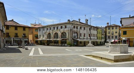 Marano Lagunare - 26th July 2016. Buildings in the main square of the small historic north east Italian coastal town of Marano Lagunare in Friuli Venezia Giulia