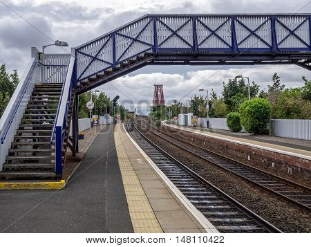 Overbridge at the train station with railtrack leading to the Forth Rail Bridge in Edinburgh, Scotland