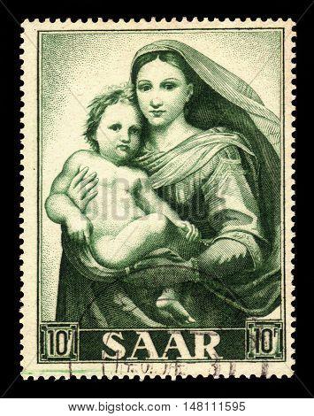 Germany, Saarland - CIRCA 1955: a stamp printed in the Saar, Germany shows painting by Raffael: