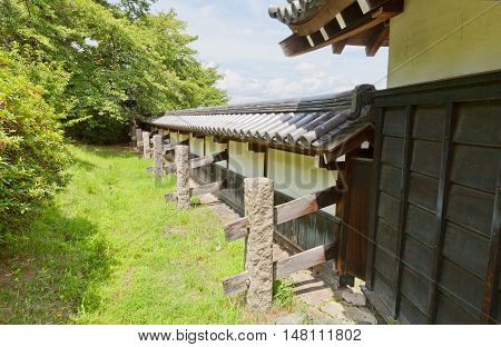 YAMATO KORIYAMA JAPAN - JULY 23 2016: Reconstructed earthen wall (hei) of Yamato Koriyama castle Nara Prefecture Japan. Castle was erected in 1580 abandoned in 1873 and partly reconstructed in 1980s