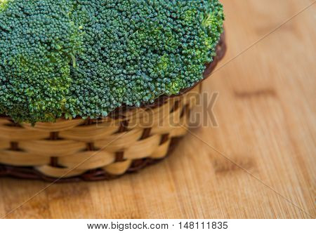 Fresh Broccoli Solated In Basket On Wooden Background