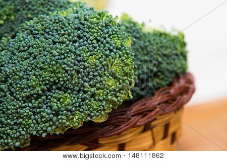 Close Up On Fresh Broccoli Solated In Basket On Wood And White Background