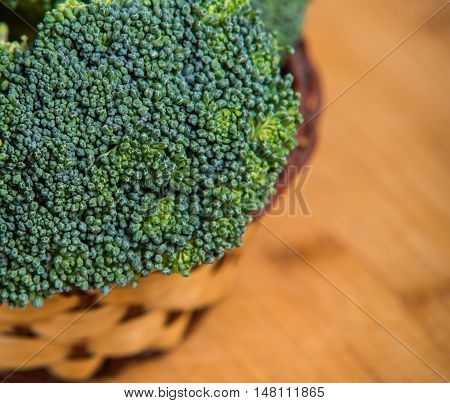 Close Up On Fresh Broccoli Solated In Basket On Wooden Background