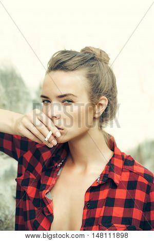 Young Pretty Girl Smoking Cigarette
