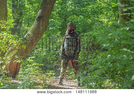 Bearded Soldier With The Gun In The Forest