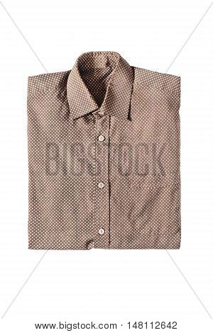 Folded brown silk polka dots shirt isolated over white